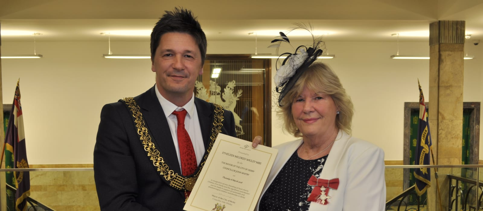 Mayor of Derby, Councillor John Whitby presents certificate to Etheleen Mildred Wigley in recognition of founding the Children First Derby charity